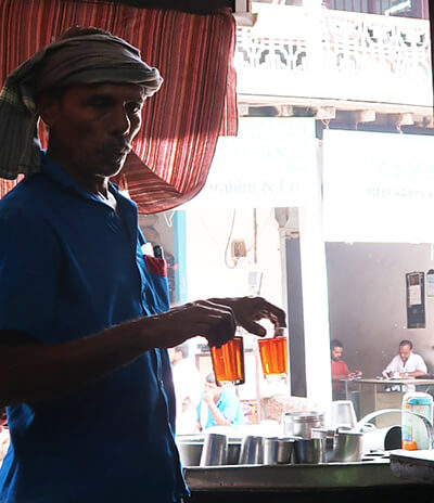 Man in turban holding drinks