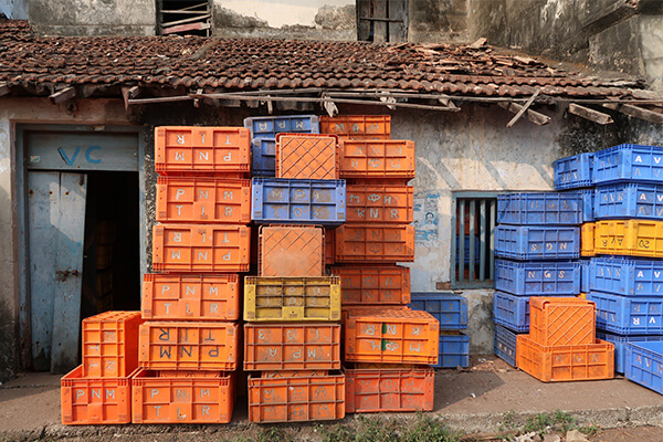 Orange and blue crates stacked